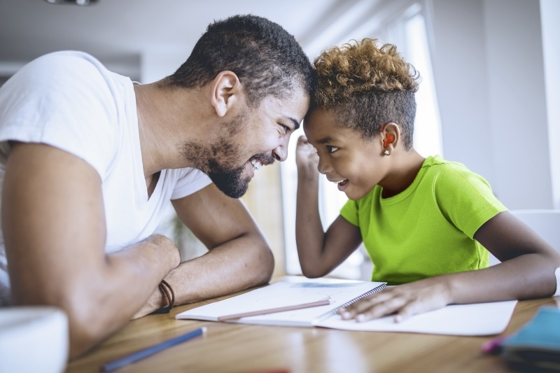 secondary_dad_and_daughter_doing_homework.jpg